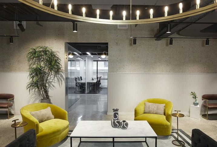 Shared office space with green velvet chairs