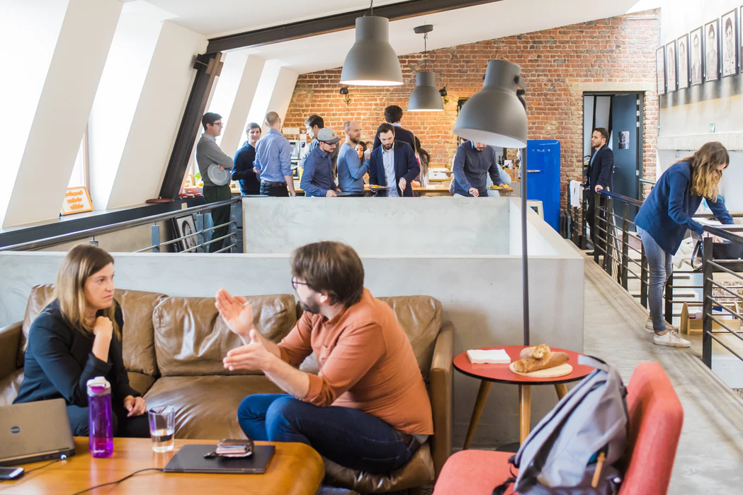 Several startup owners collaborating in an open office design
