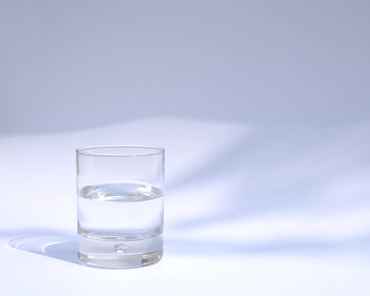 glass of water on a white desk