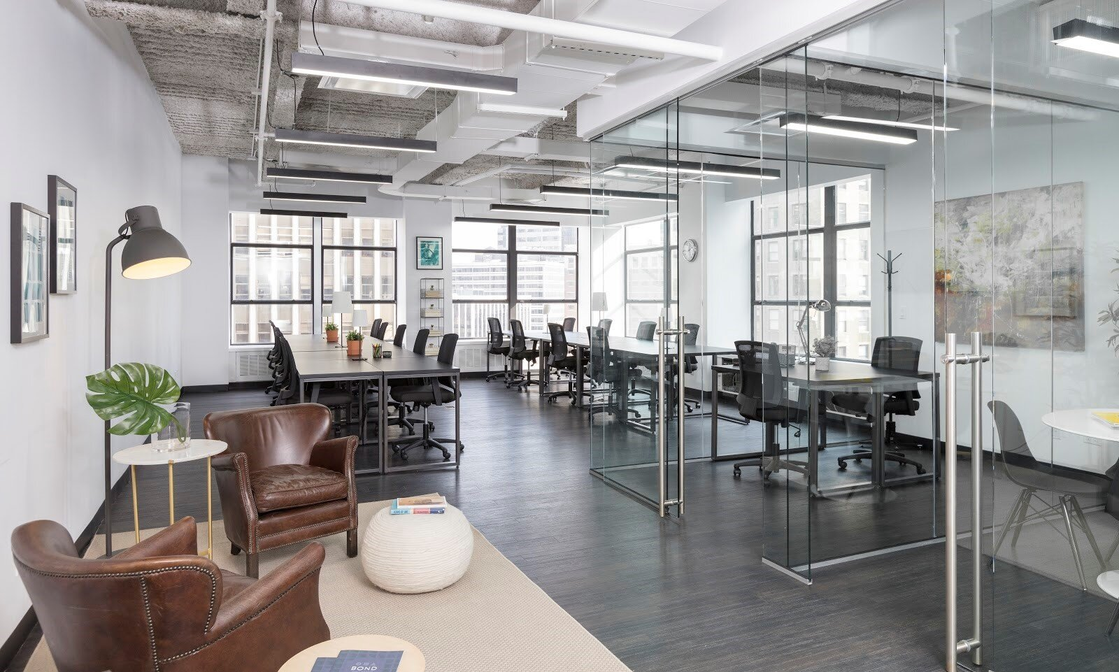 Coworking space with glass walls as example of office design
