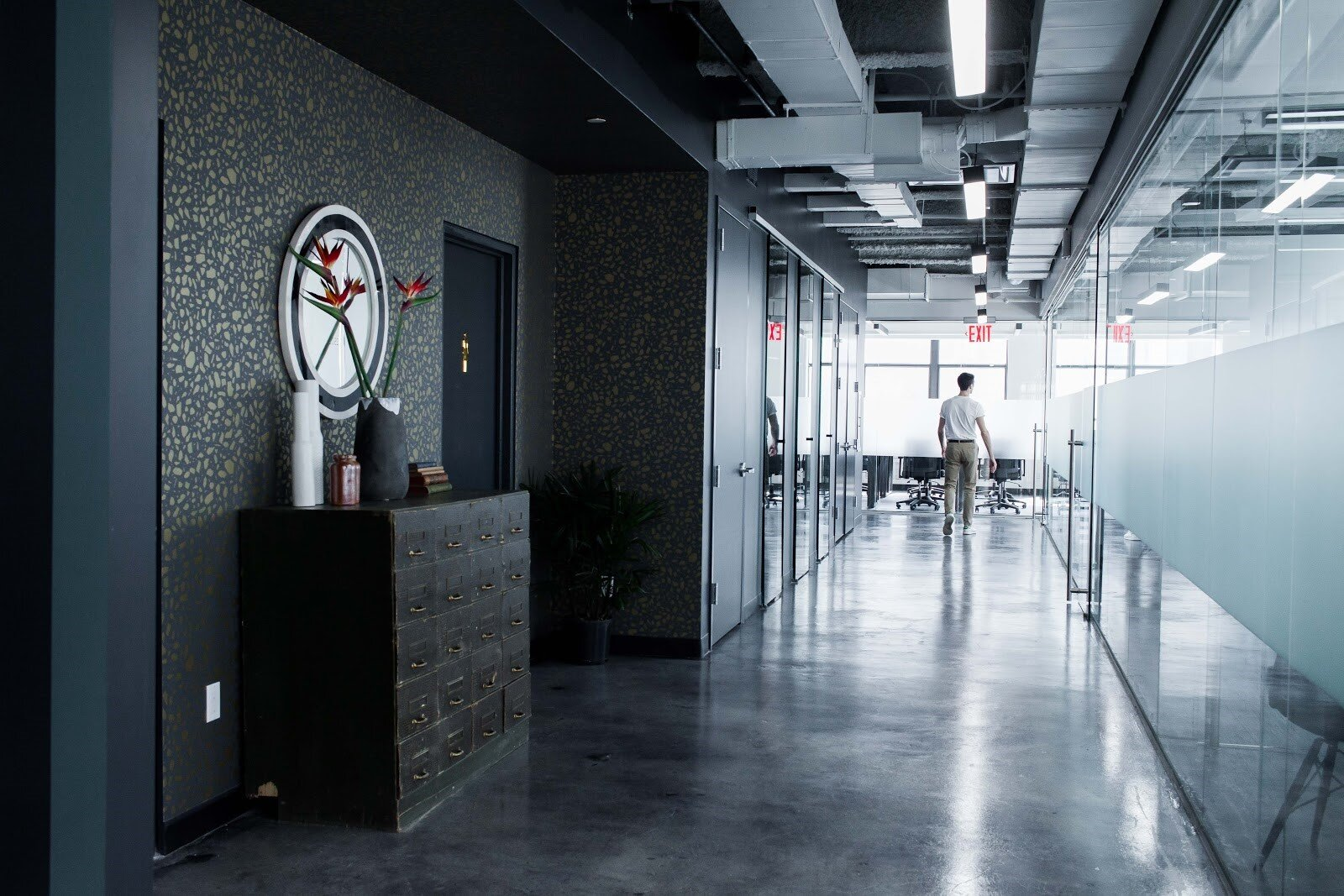 Office design with shared working spaces and glass doors