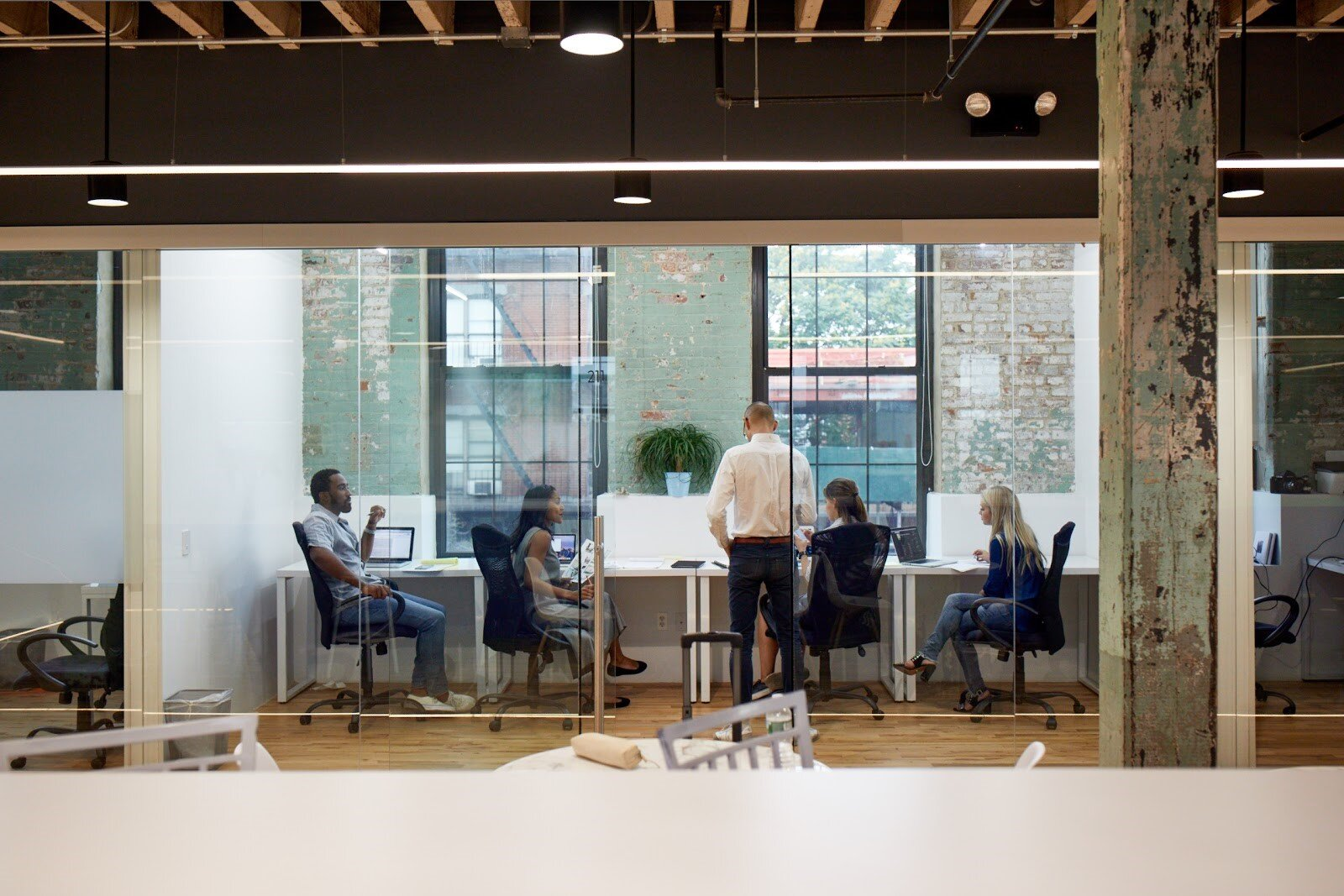 Professionals collaborating in modern office spaces