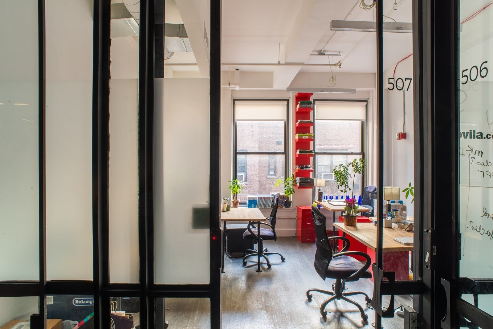 An open office with red desks and cabinets