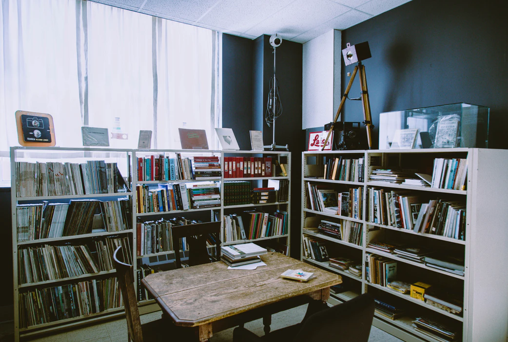Innovative Office with bookshelves and a small table