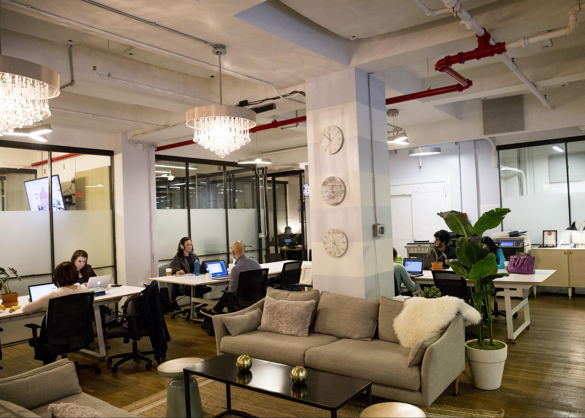 Shared desks, sofas, and tables in a gorgeous office