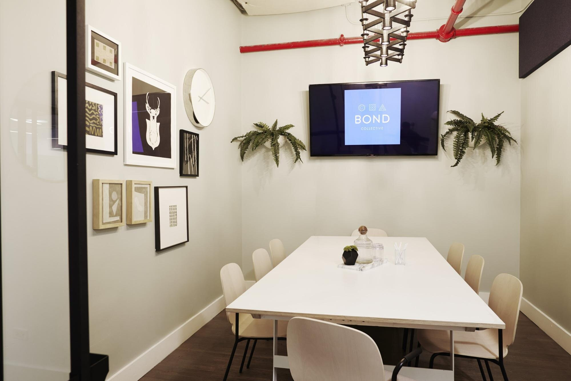 Conference room  with white table and chairs in a flexible office space