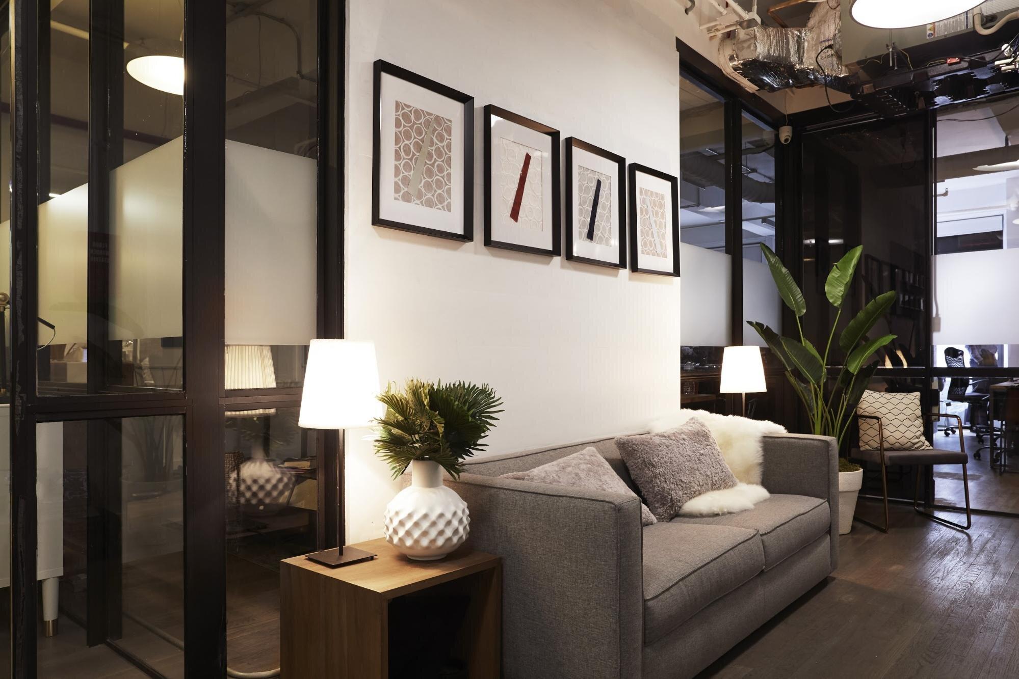 Comfy gray sofa in a Bond Collective flexible office space