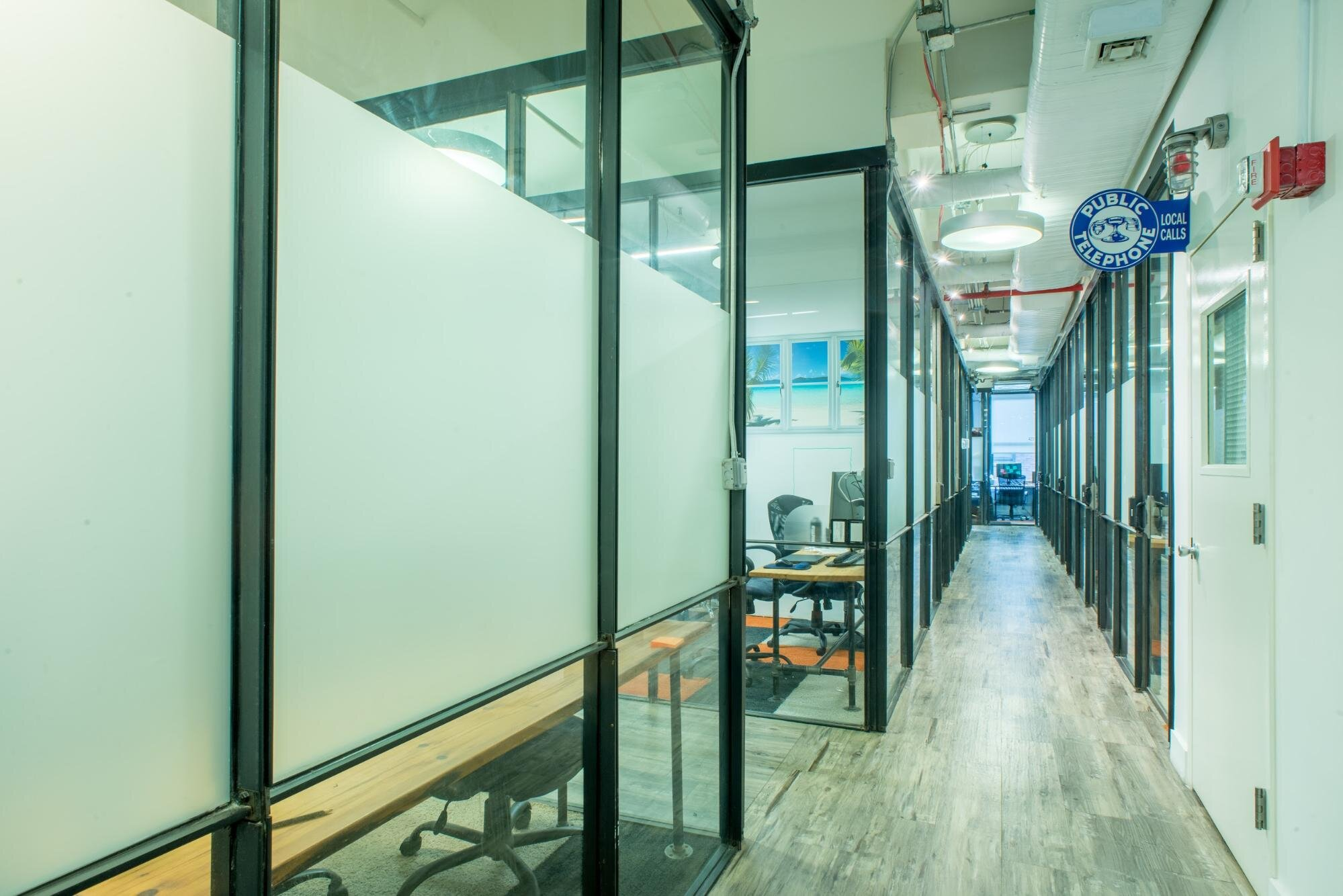 Sustainable Offices in a coworking space with glass walls