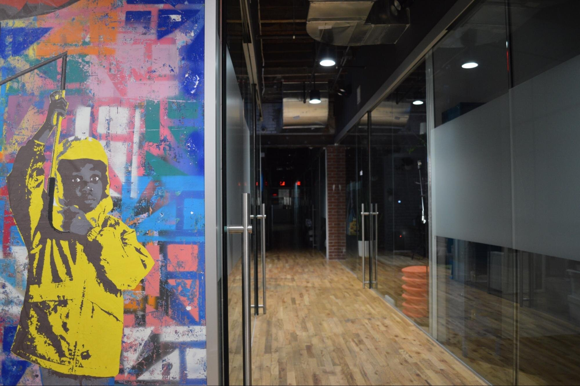 Art work on a glass wall connecting several sustainable offices