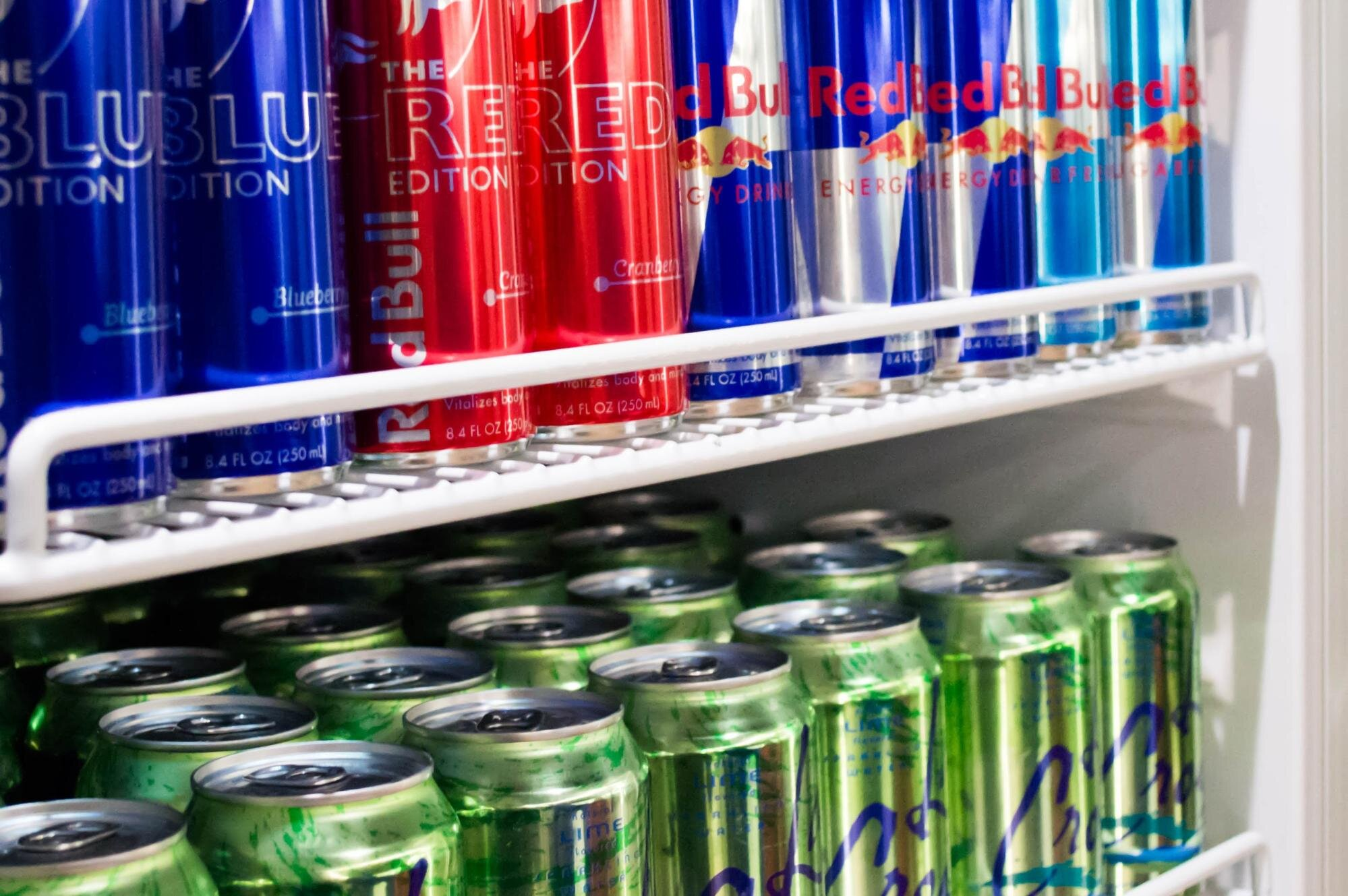 Energy drink cans inside a refrigerator