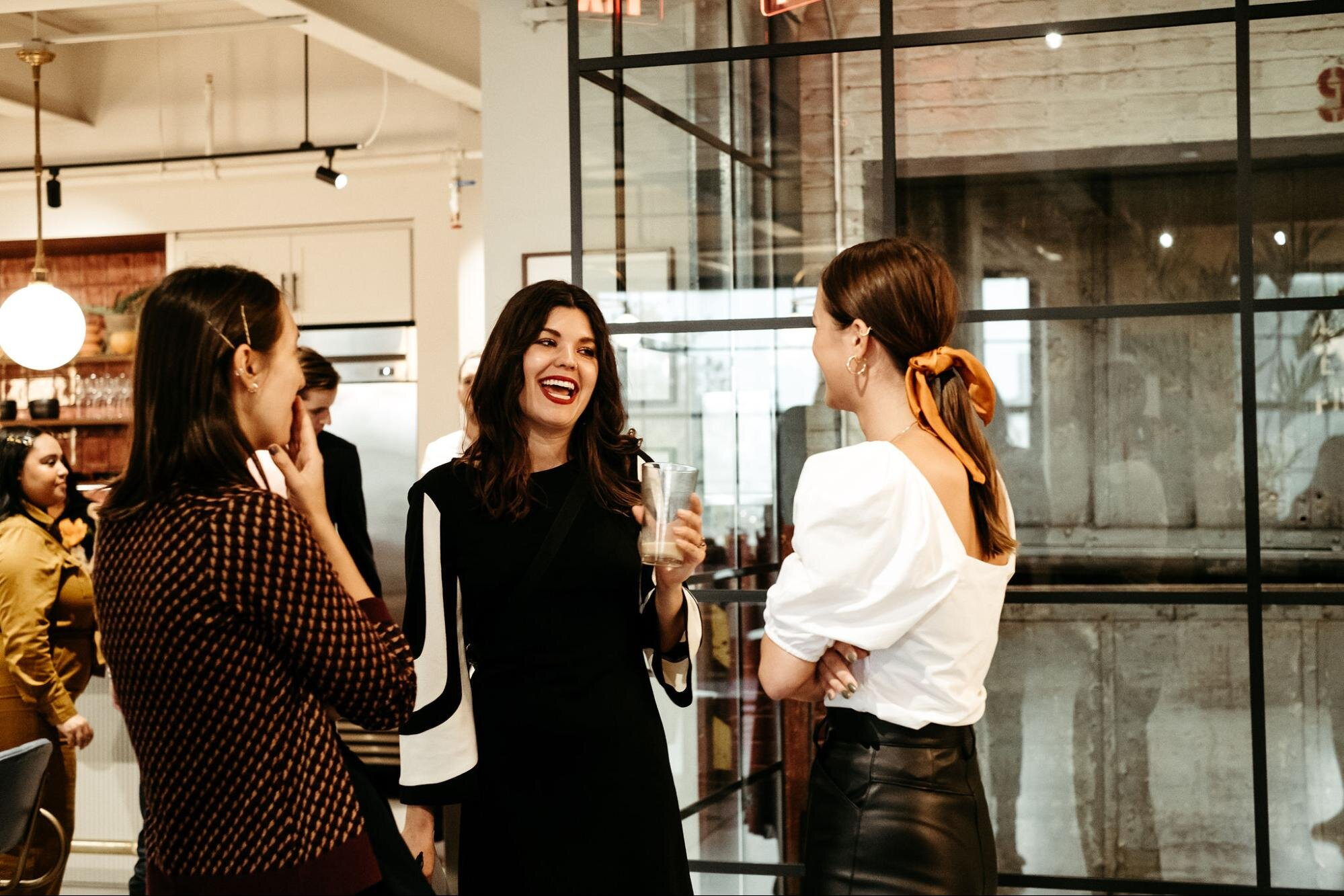 Three female coworkers communicating at work