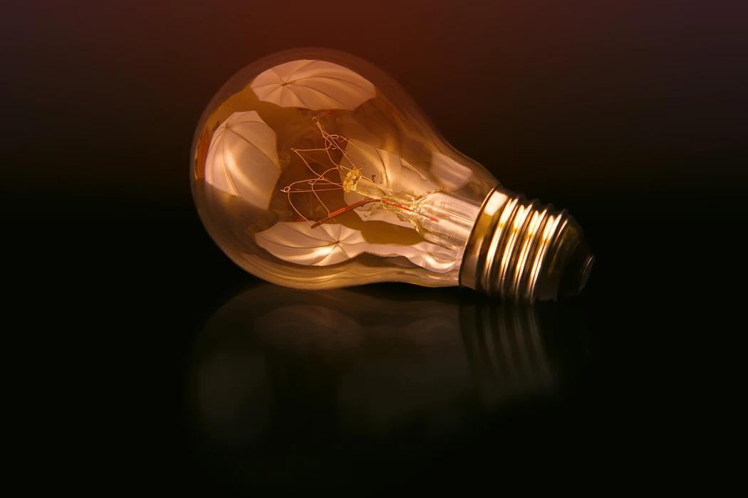 Light bulb on a black surface