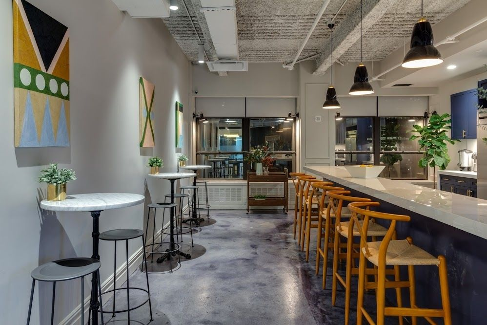 Bar and tables at a Bond Collective coworking space