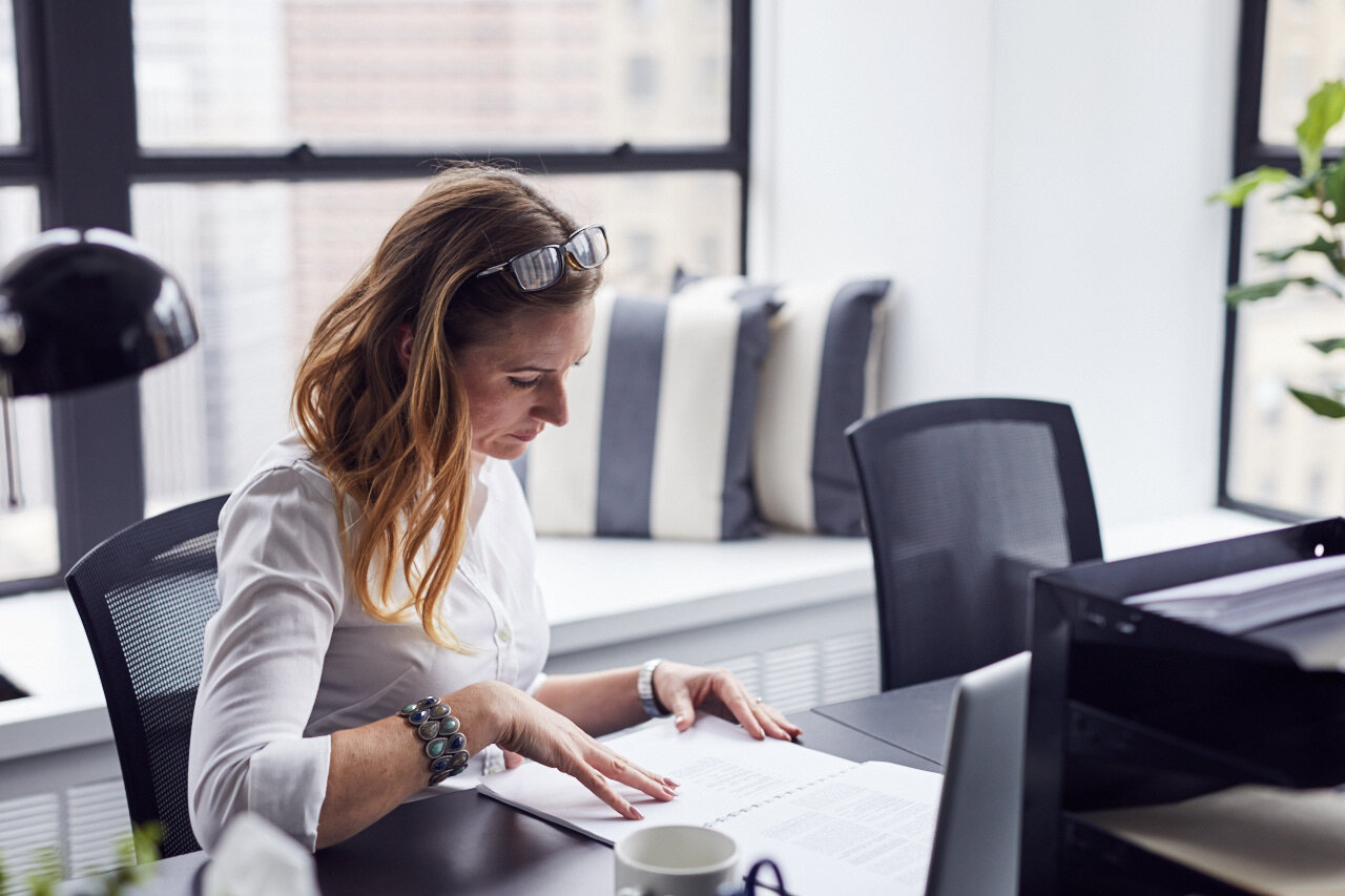 Woman looking at how much it costs to start a business