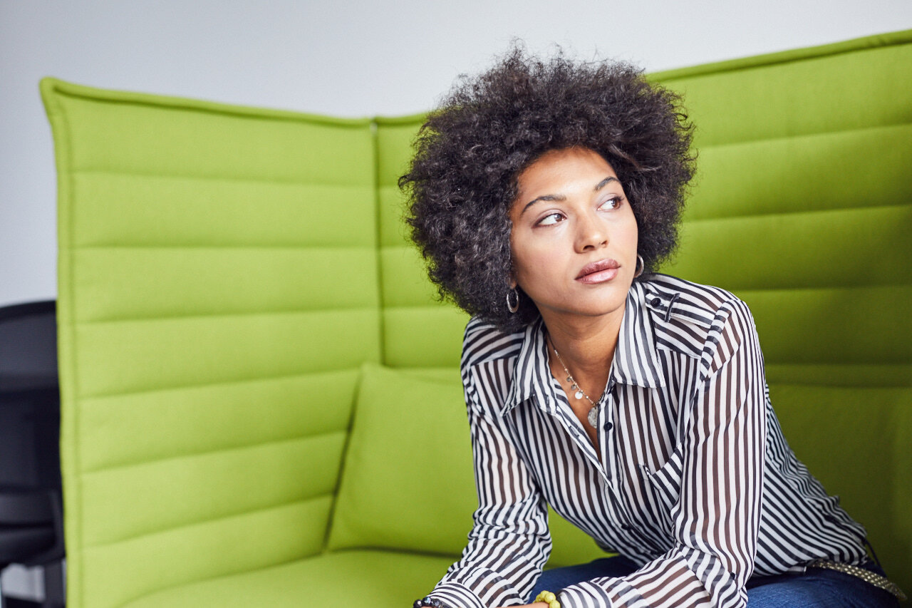 """woman pondering the question """"how much does it cost to start a business"""""""