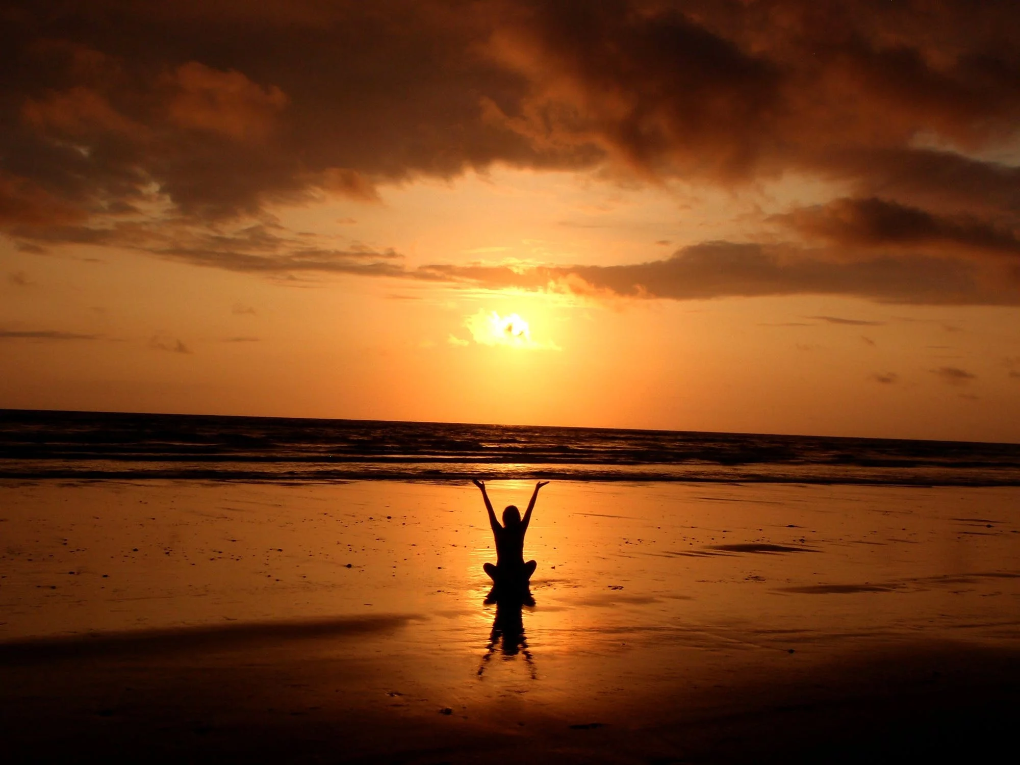 Yoga at the beach on a mental health day
