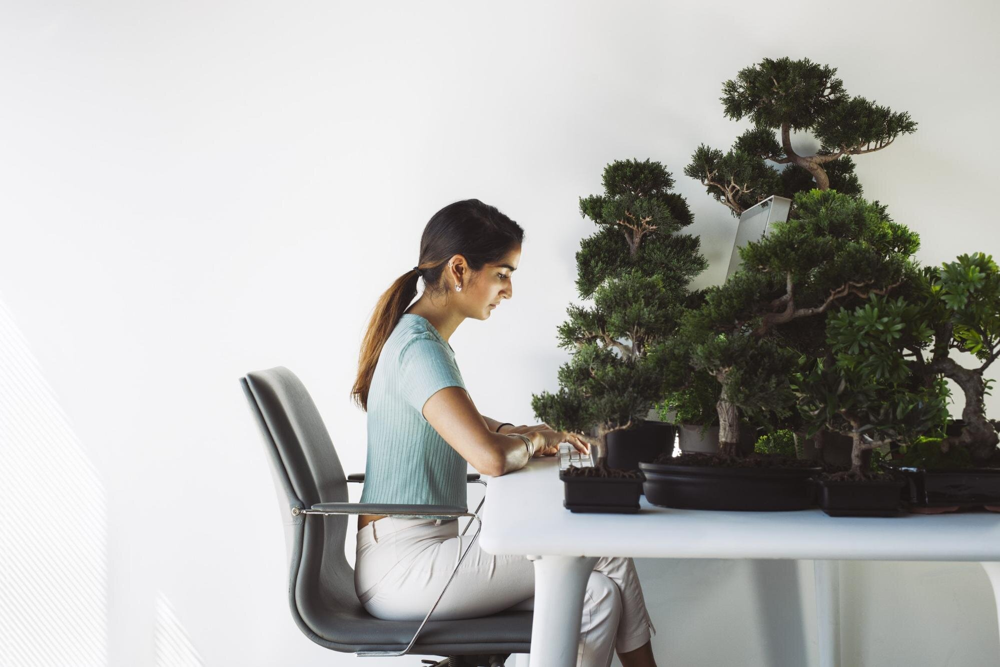 woman working in home office with plants