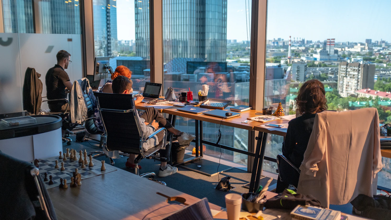 team members working in office with a view