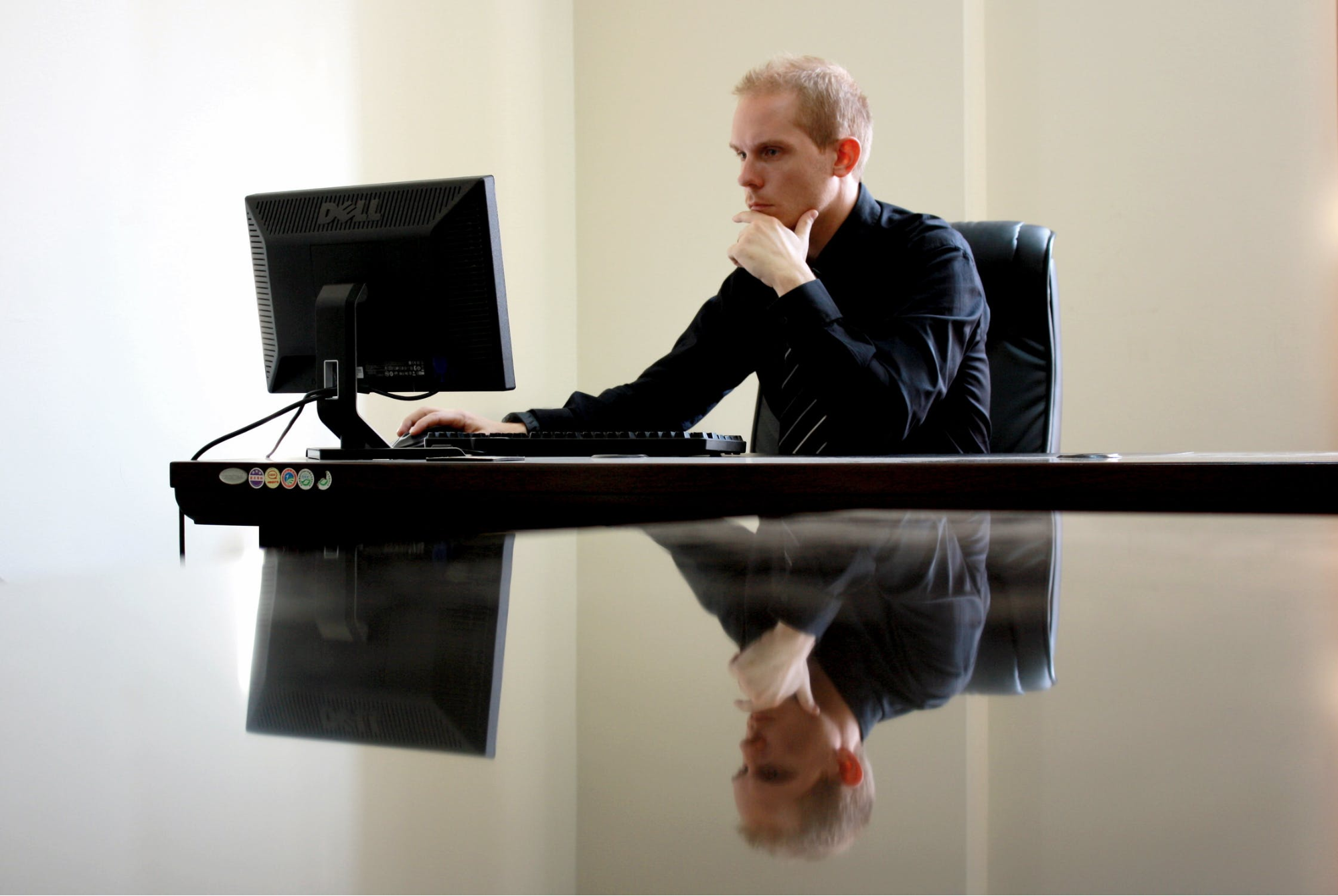 Man working in a quiet space in collaborative workspace