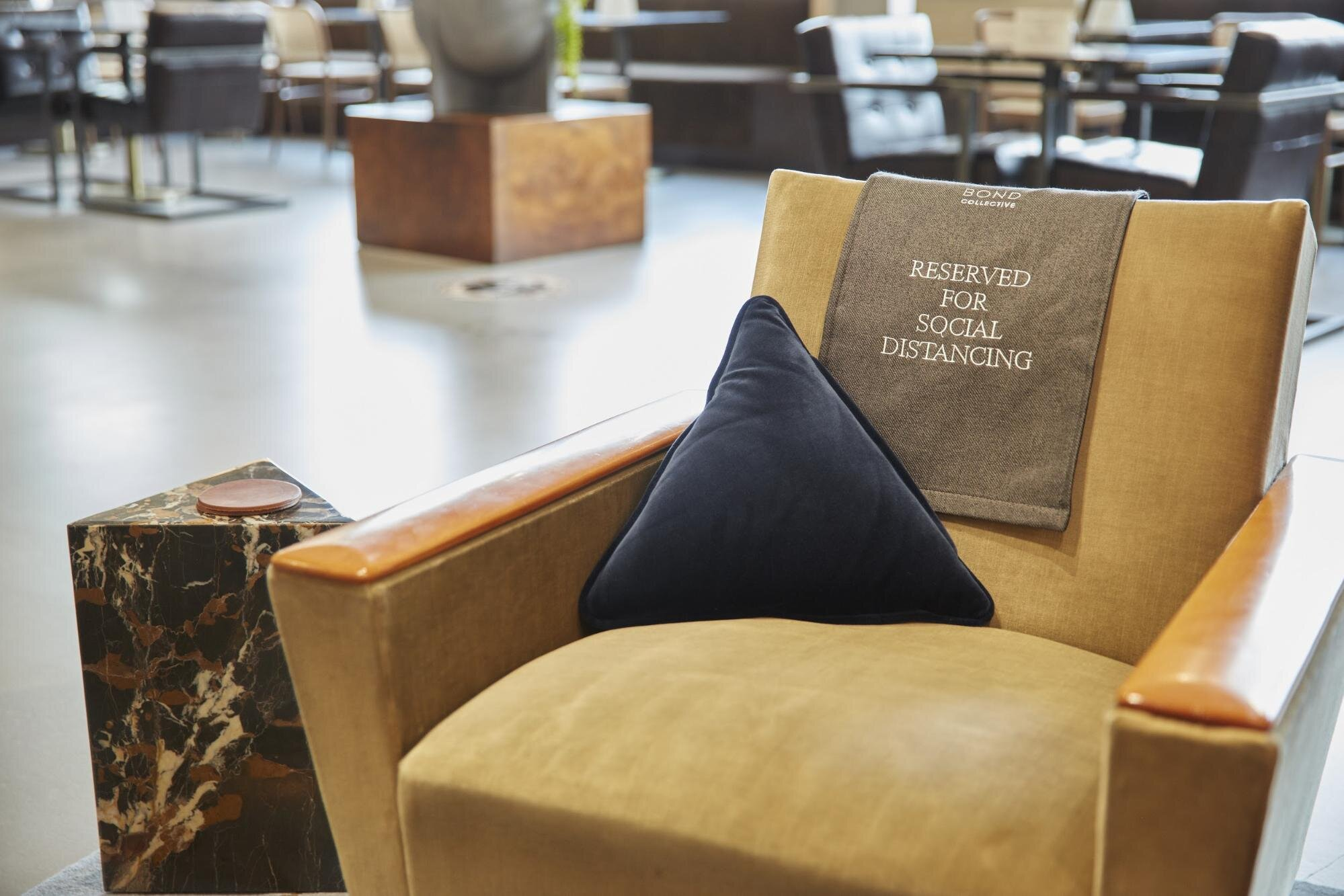 decorative couch signs  social distancing in the workplace