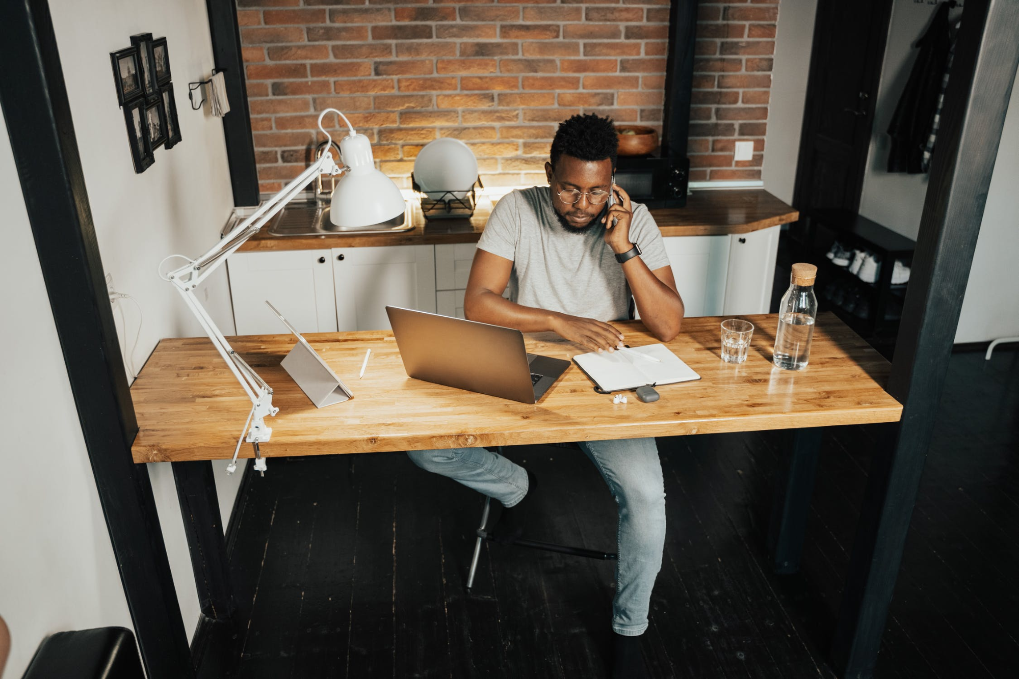 Man doing remote work from a desk at home