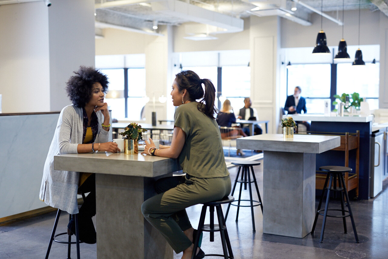 two women out discussing an office lease