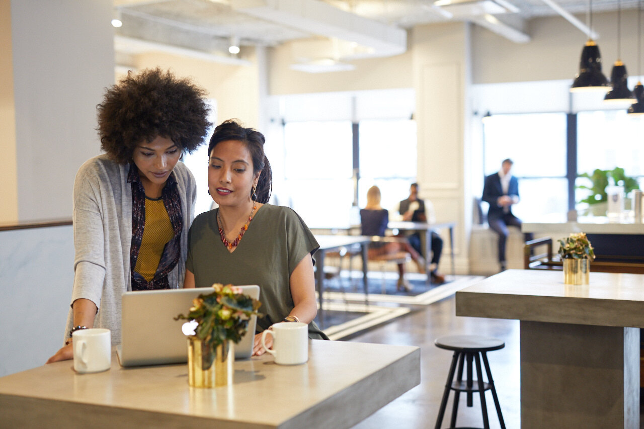 two woman researching what is coworking