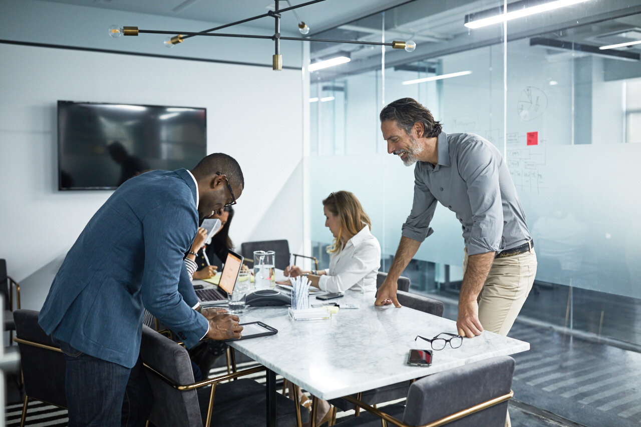five employees working in shared office space