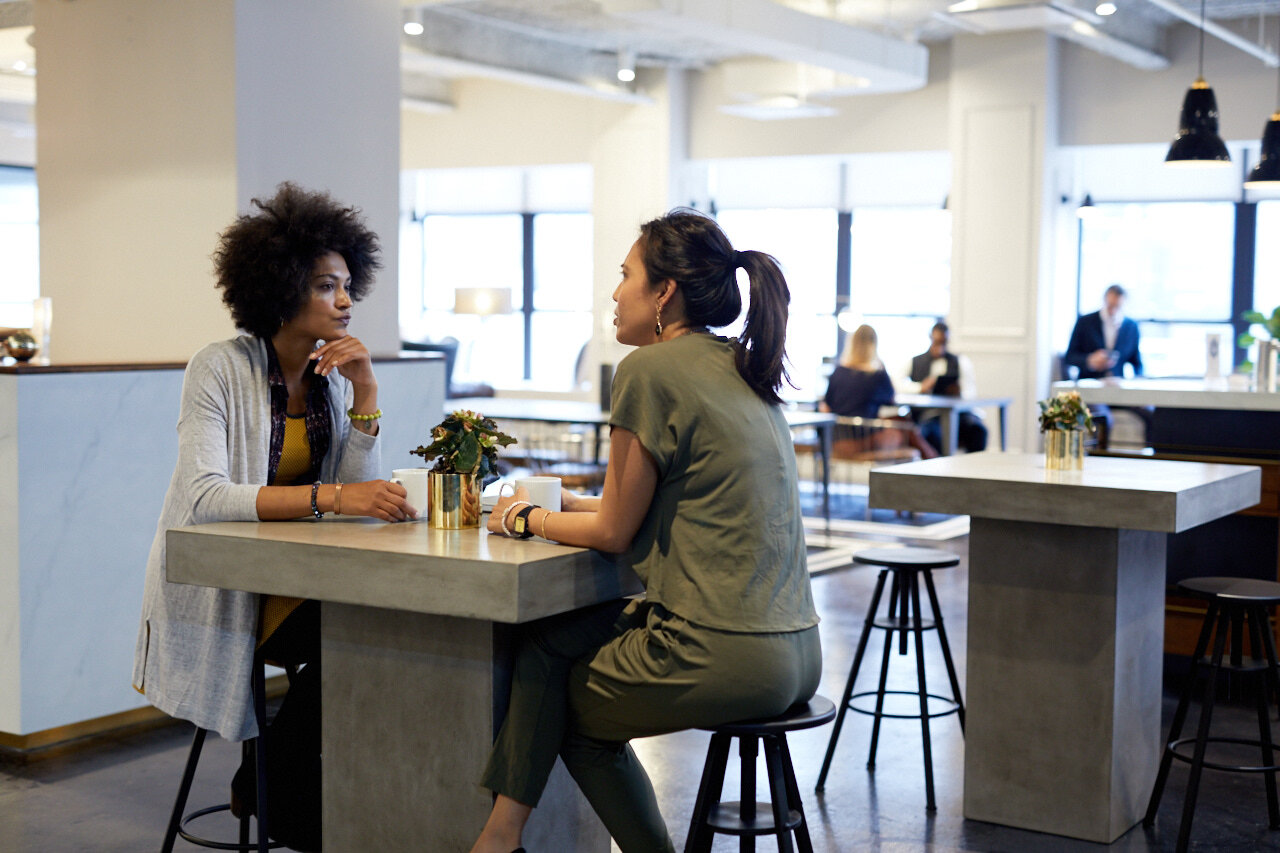Two employees talking about the differences between diversity and workplace inclusion