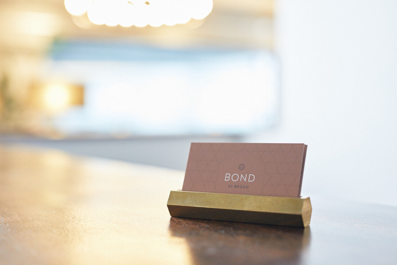 Bond Collective business card in holder