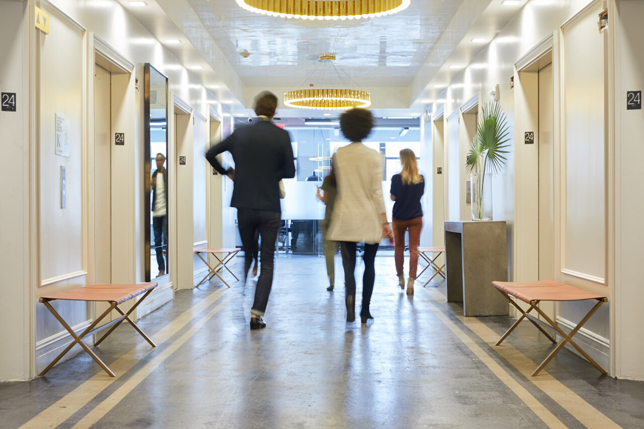 Employees walking through a coworking space