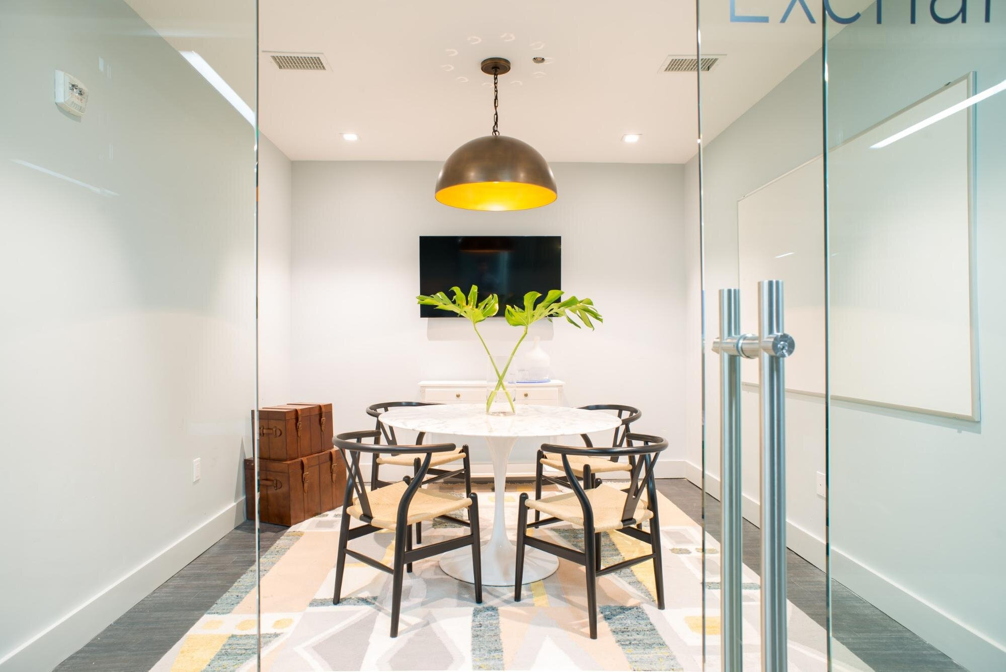 Office space with a simple table and great lightening with glass door