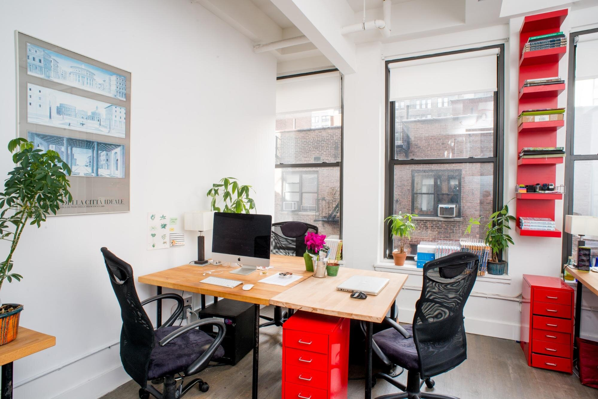 Inside a small office with a shared desk