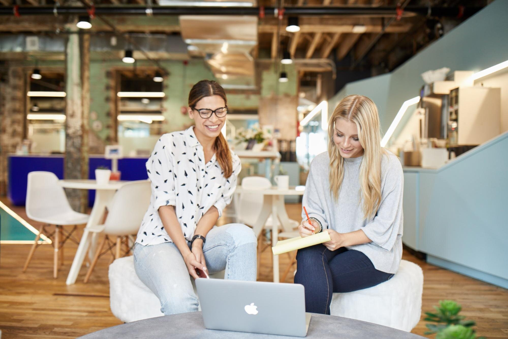 Two employees working on improving workplace wellbeing