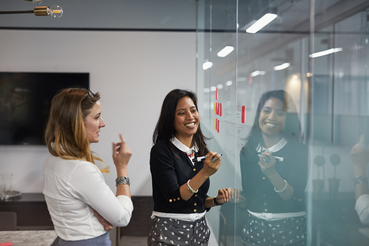 Two employees working in an innovation space