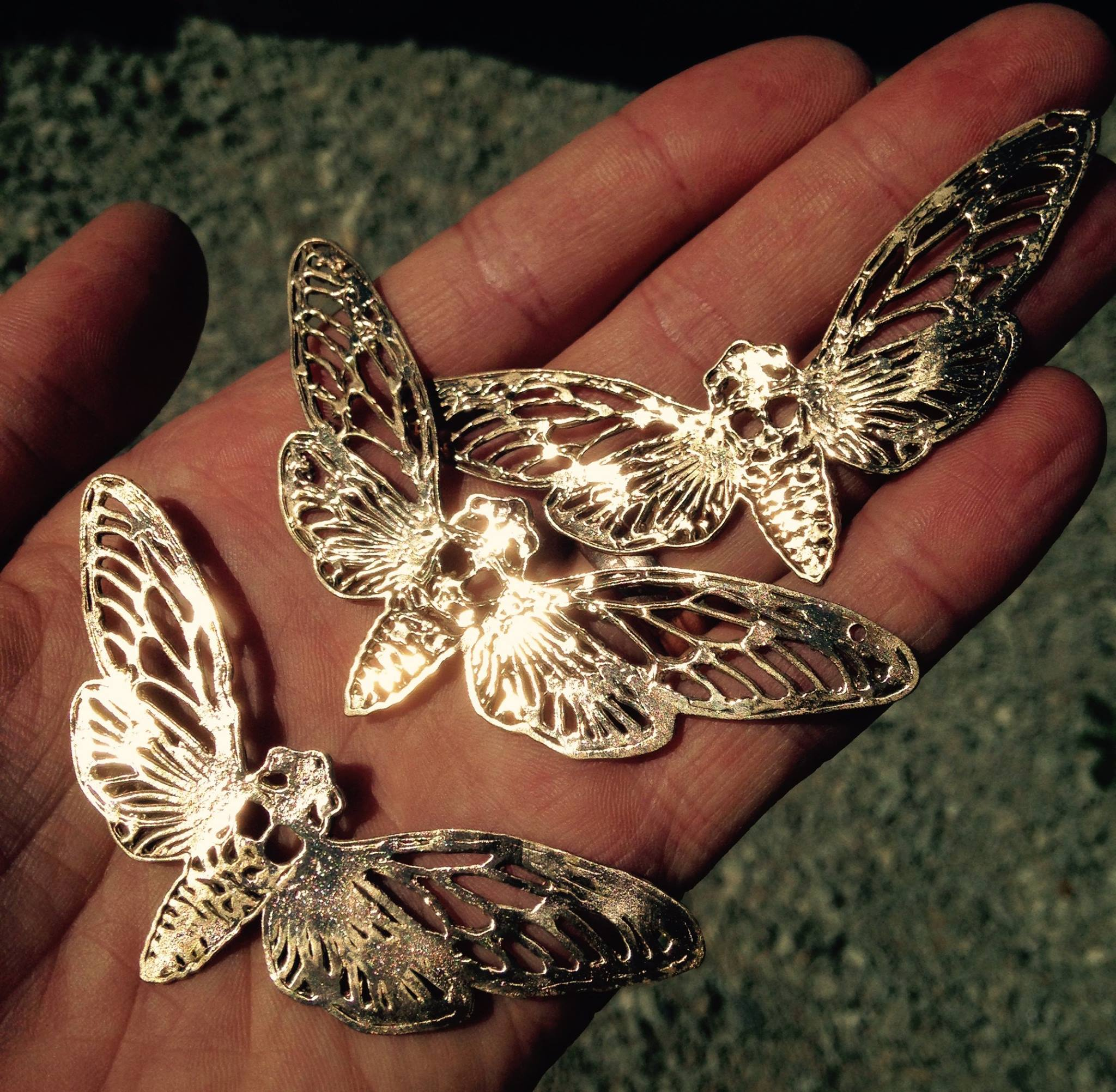 Cicada pendants, drawn in adobe illustrator and printed in bronze with the Mini Metal Maker.