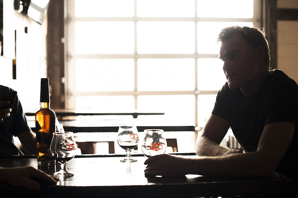 Photo by Colin Bridge feat. Rob Dietrich, head distiller at Stranahan's tasting this beer from barrels.