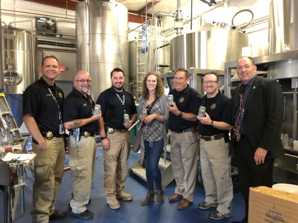 Representatives from the Douglas County Sheriff's Office during canning day.