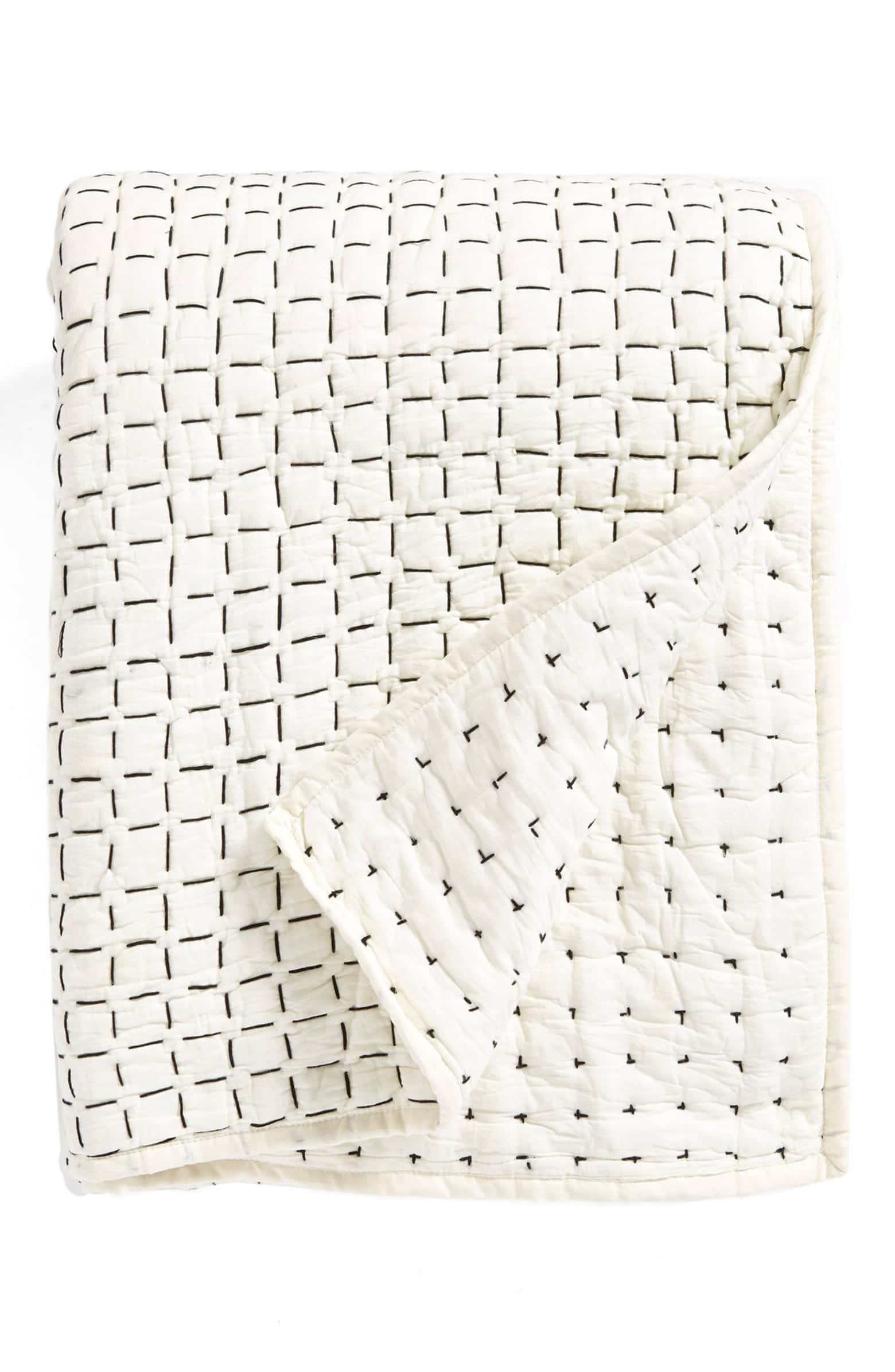 Like  this DKNY whole cloth quilt  available at Nordstroms.