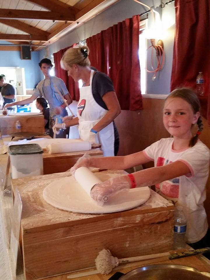 Lefsa Team hard at work at Vista Viking Festival, where lefsa comes fresh off the griddle all day. (Photo. Julie Watts)