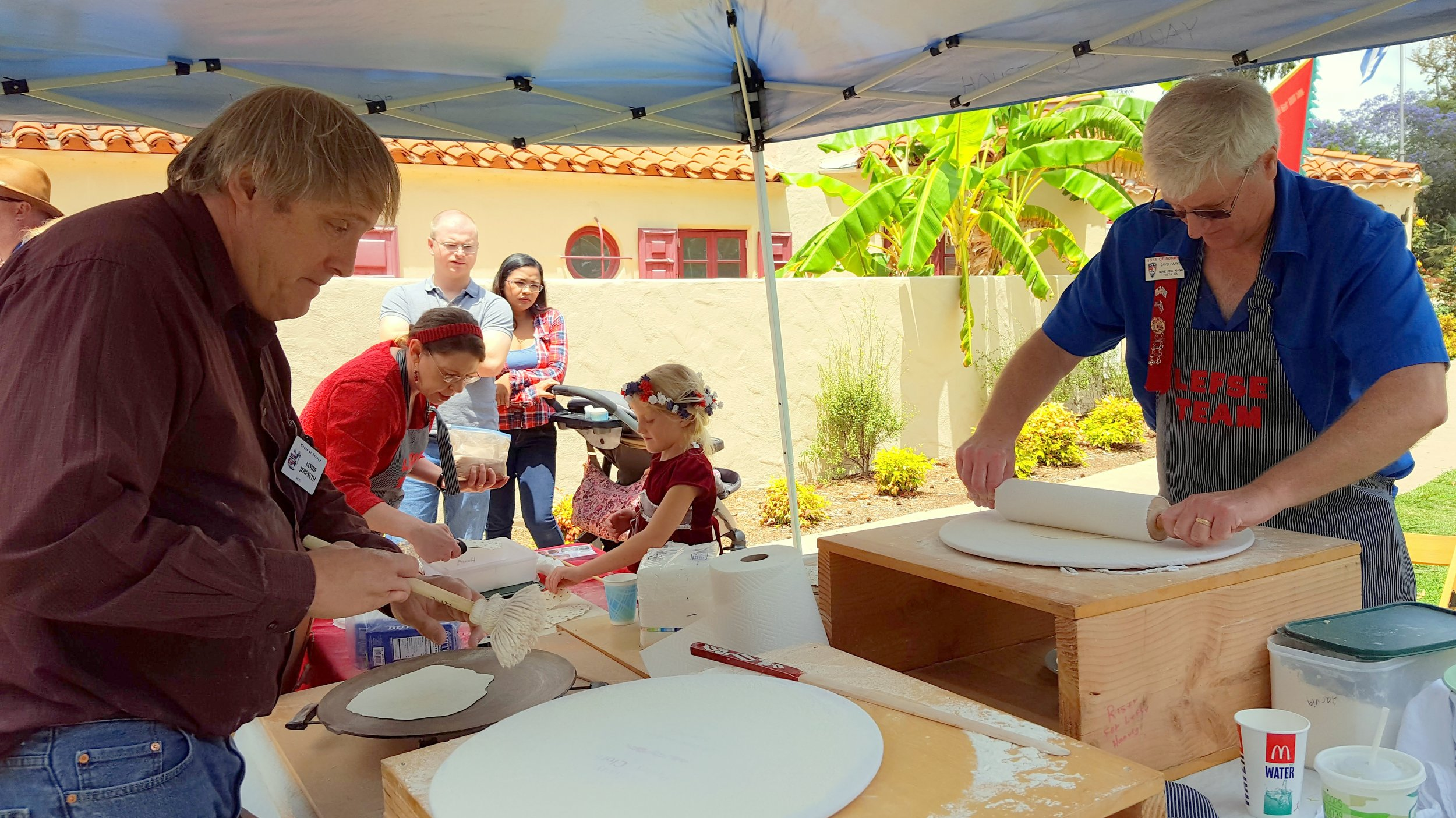 James Jerpseth and David Haavig making fresh lefsa at House of Norway Lawn Program in Balboa Park. (Photo. James Nelson.Lucas