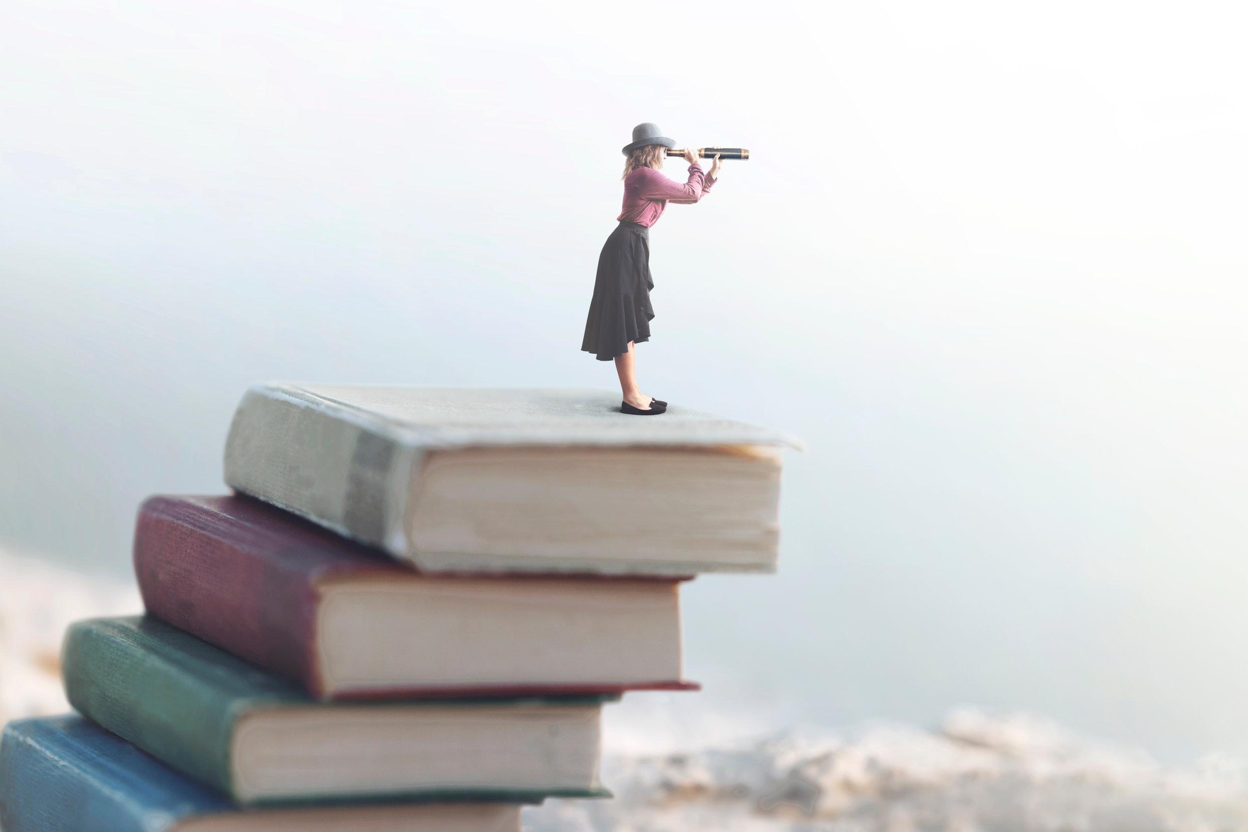 Woman Standing on Book.jpg