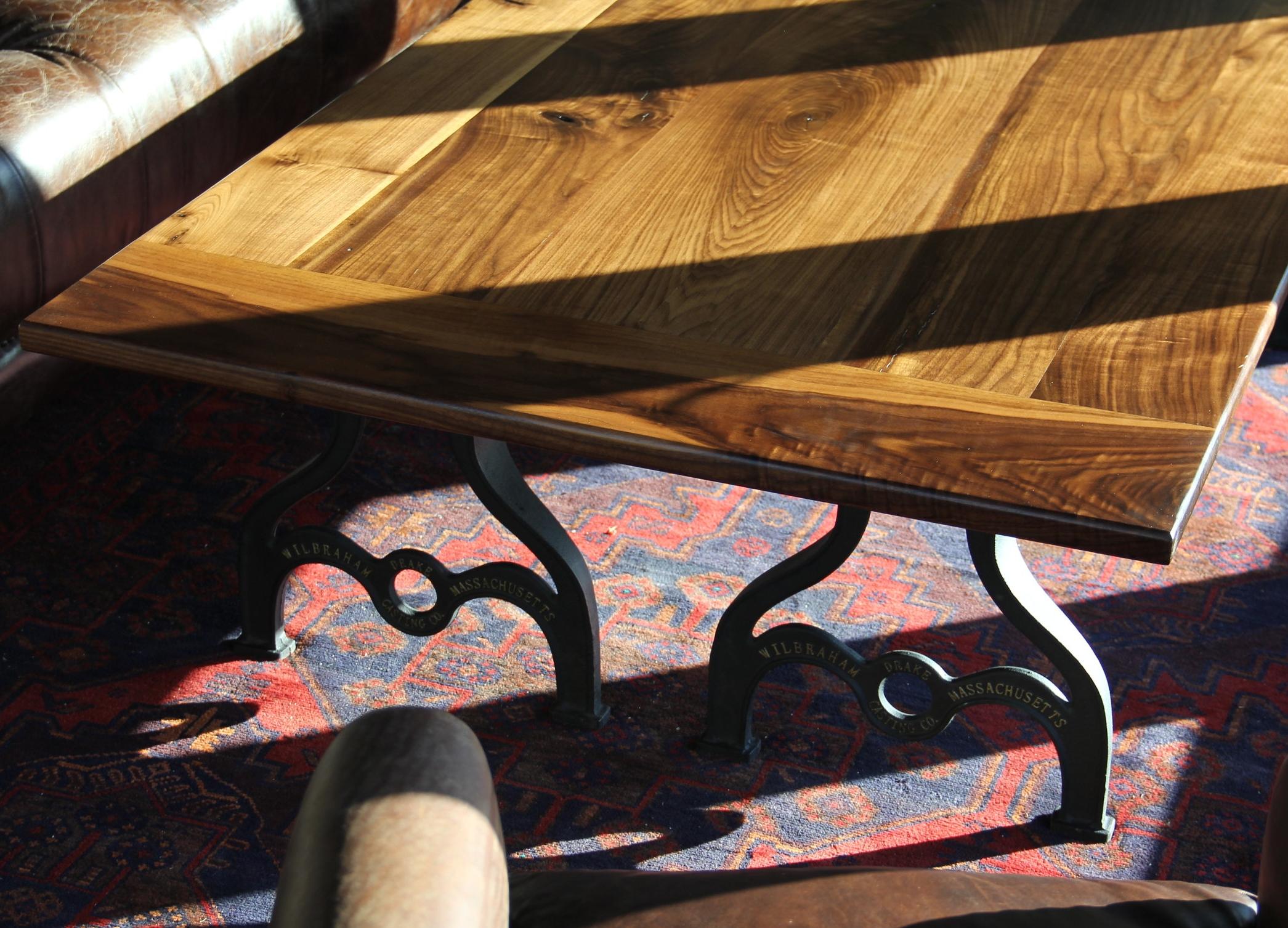 Walnut Farmhouse Coffee Table with Cast Iron legs.