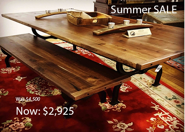 7 Ft Walnut Farmhouse and matching bench with cast iron trestle base. Sale price: $2,925