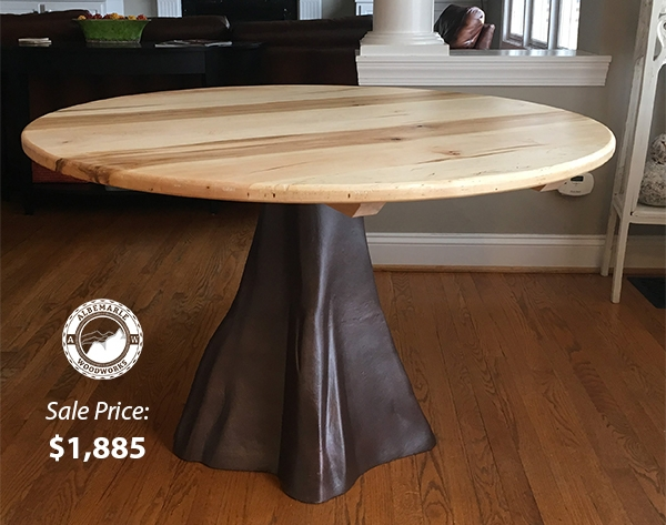 48 in Round Ambrosia Maple table with Enchanted Forrest Tree Trunk cast iron base. Sale Price: $1,885.