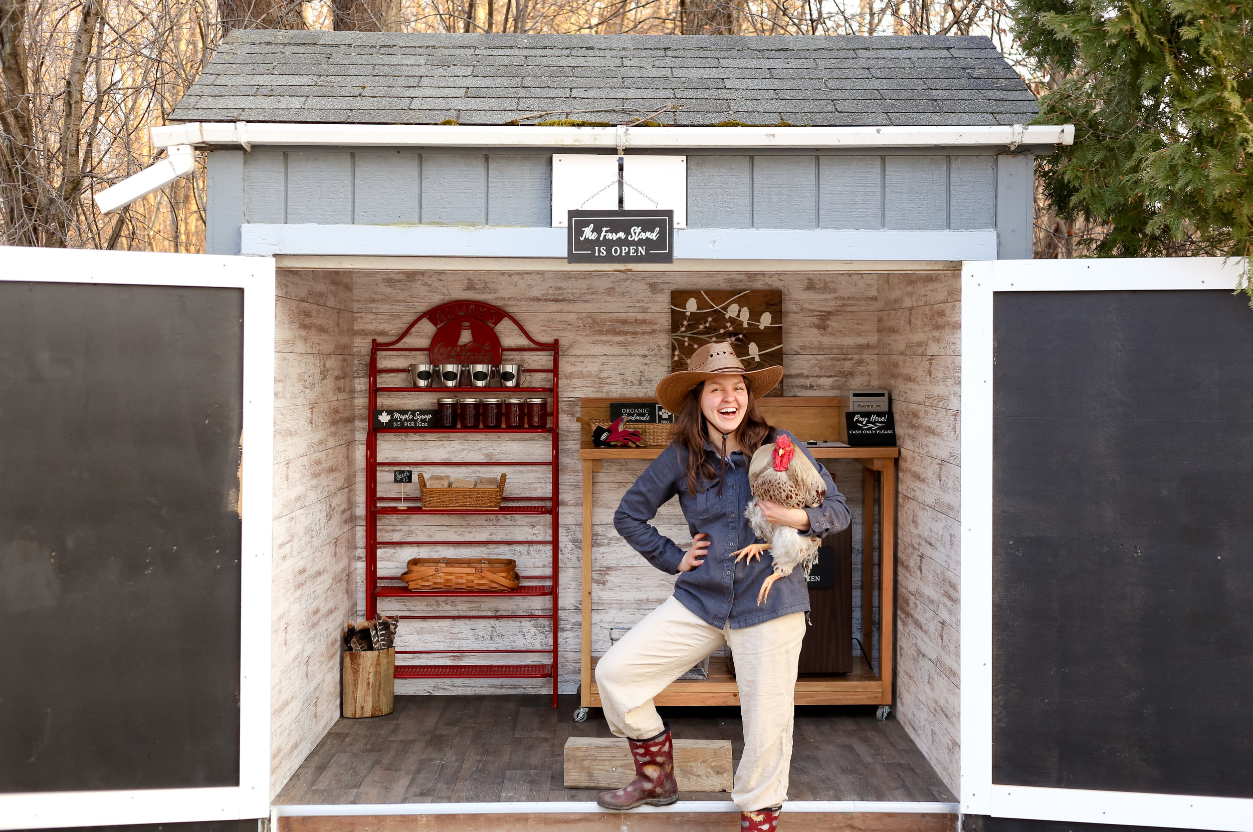 Female Farmer Kelsey Jorissen with her farmstand.jpg