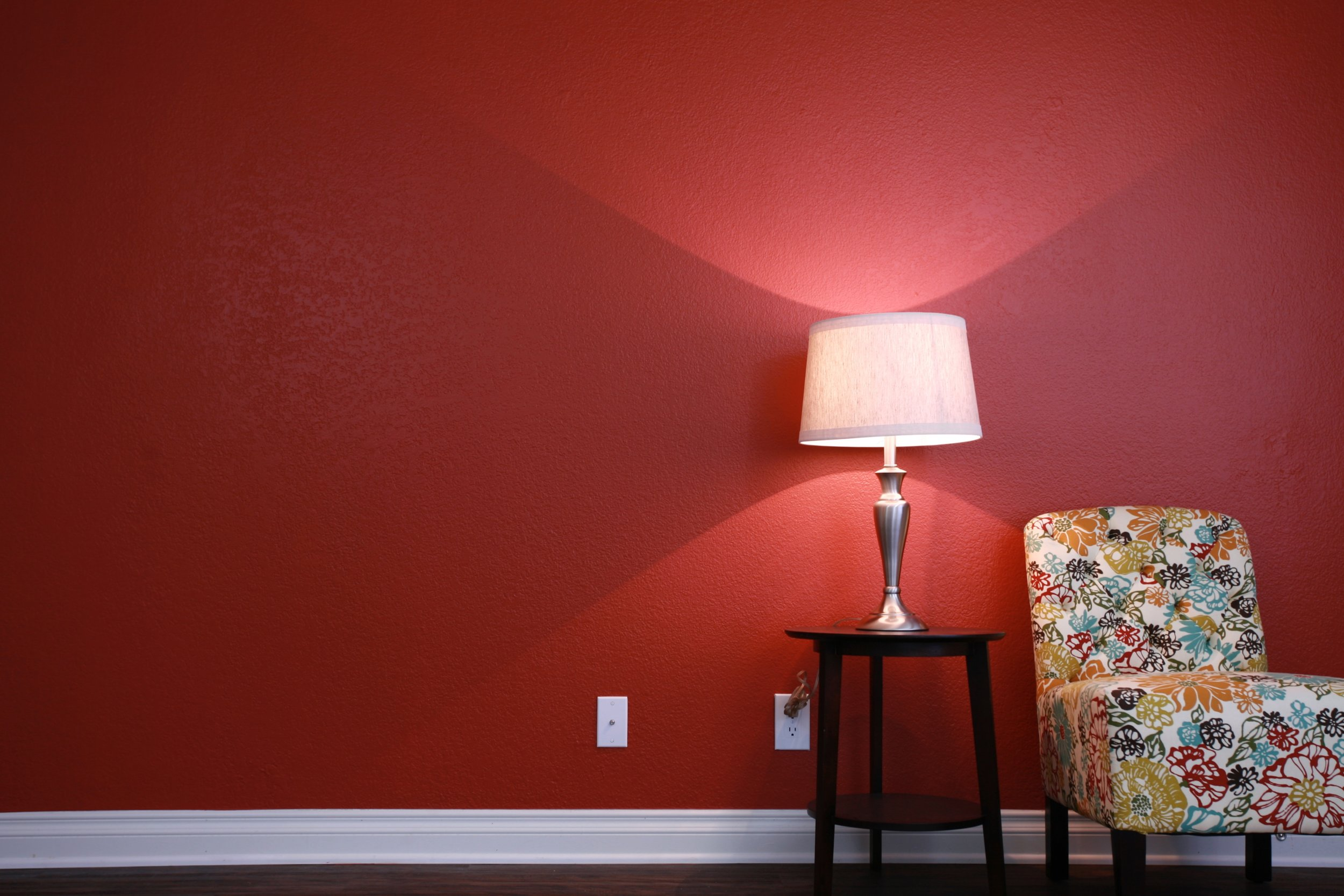 Red accent wall in living area at Serrano