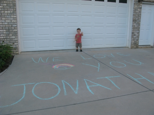 An excited Tyler waiting to welcome his little brother home.