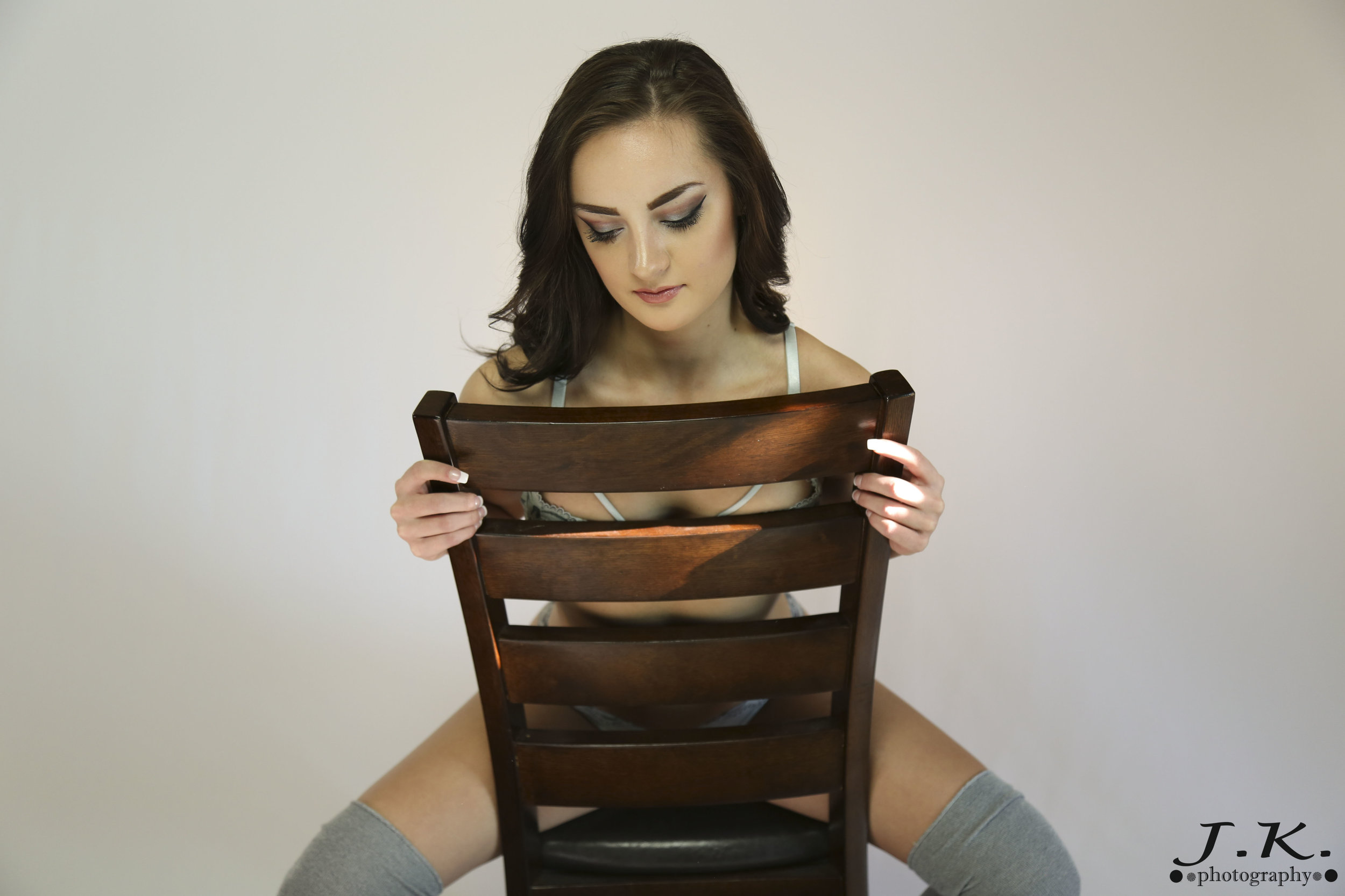 Maddi_Straddles_Chair_Looking_Down.jpg