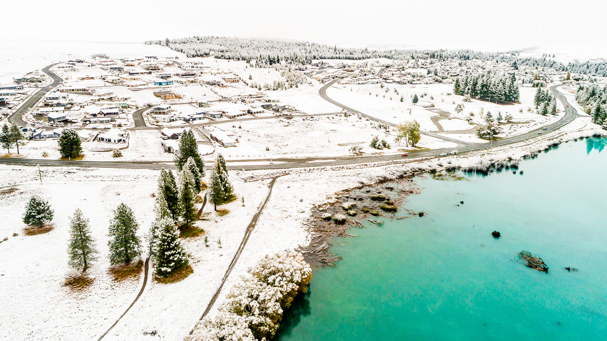 snow-flight-drone-aerial-photography-road-trees-lake-tekapo-snowing-autumn-dji-phantom.jpg